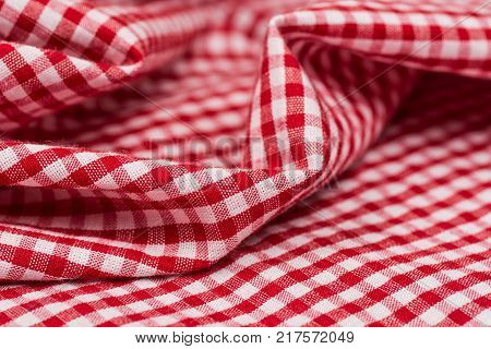 Checkered tablecloth kitchen selective focus. the white and red checkered background