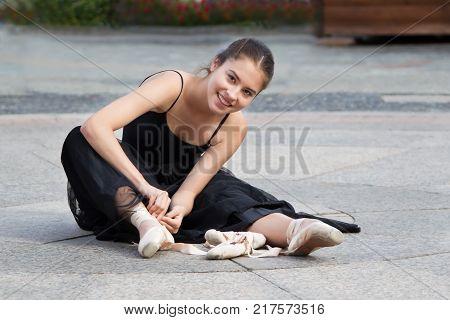 Russia Moscow Izmaylovsky Park August 27 2017. International Photo Festival.Ballerina wears pointes. Street ballerina.