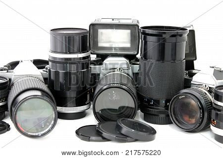Set of old camera with lenses and a flash camera isolated on white background