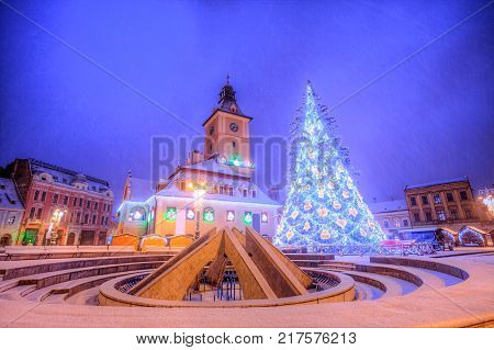 Beautiful Christmas tree near Council house in the main center square of Brasov town, Transylvania region, Romania