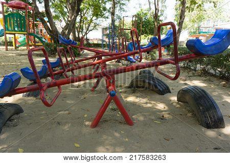 Older playground equipment in Ecuador, teeter-totter, seesaw