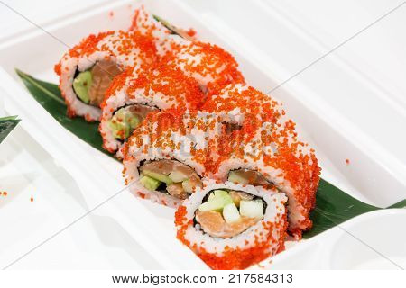 Close up of sushi served on plate.