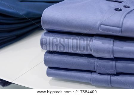 stack of neatly folded clothes on the counter