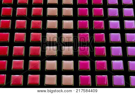 The palette of nail polish as a background