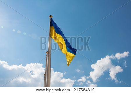 Ukrainian flag fluttering in the blue sky