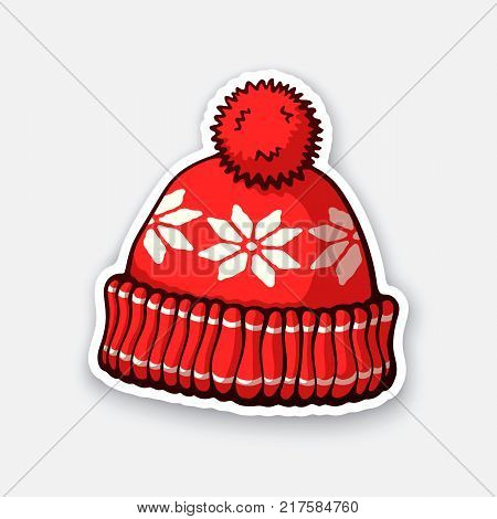 Vector illustration. Red winter hat with pompon and snowflake pattern. Christmas headdress made of wool for cold weather. Sticker in cartoon style with contour. Isolated on white background