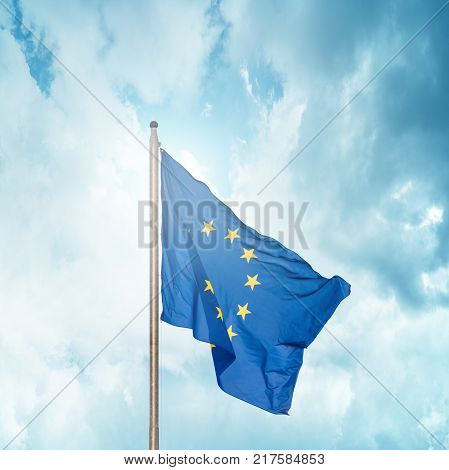 The flag of the European Union fluttering on the flagpole