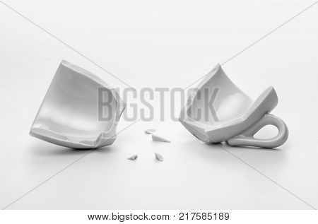 two halves of broken cup disintegration or accident concept