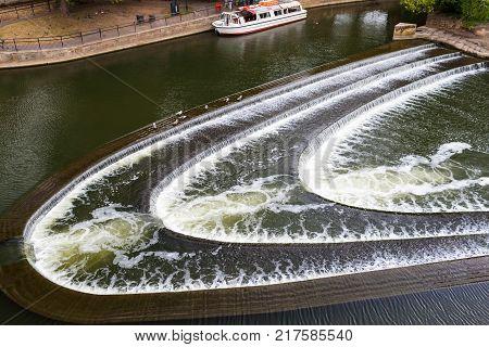 River Avon, Bath, western England, with artisitc water flow