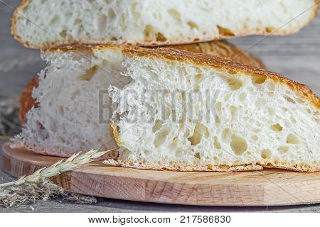 White bread artisan handmade, hearth-baked loaves in the yeast, close-up