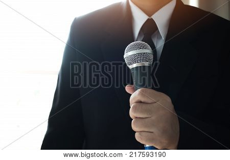Journalists filing microphone interviewing to businessman. Smart Reporter taking interview and speech with microphone at presentation in conference Business seminar concept