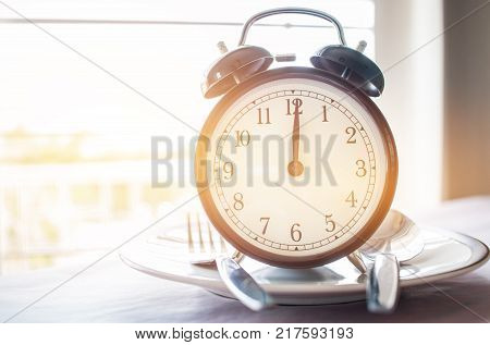 Retro stopwatch to put on plate. Weight loss for good Healthy. Diet is sum of food consumed by person or other organism. Lunch Time to diet concept.