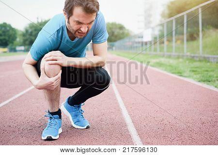 Running Athlete Feeling Pain Because Of Injured Knee