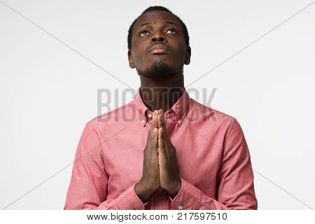Closeup Of Young African American Man Isolated On Gray Background Looking Stressed, Putting Hands To