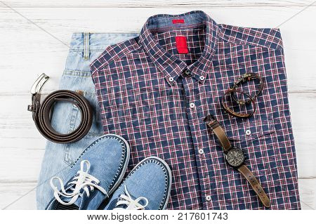 Men's casual outfit. Men's fashion clothing and accessories on white wooden background, flat lay, top view