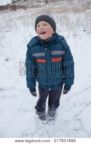 The boy was full-grown in the winter and laughed