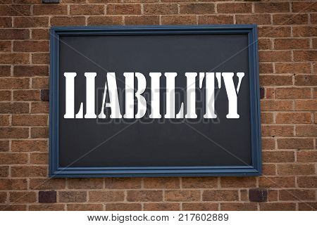 Conceptual hand writing text caption inspiration showing announcement Liability. Business concept for  Accountability Legal Blame Risk written on frame old brick background with space