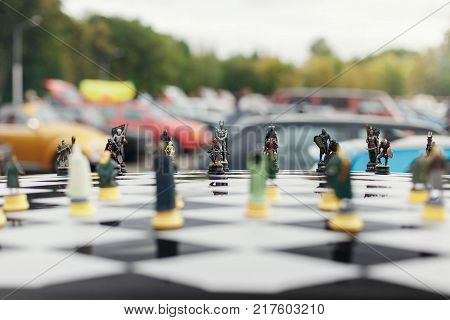chess Board with figures on the roof of the car. Airbrush and tuning the car