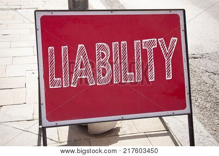 Conceptual hand writing text caption inspiration showing Liability. Business concept for Accountability Legal Blame Risk written on announcement road sign with background and space