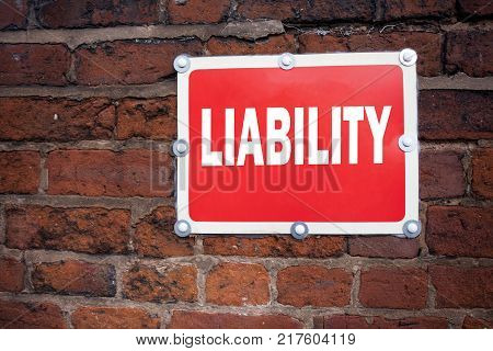 Hand writing text caption inspiration showing Liability concept meaning Accountability Legal Blame Risk written on old announcement road sign with background and space