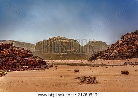 Desert landscape vista under blue hazy skies