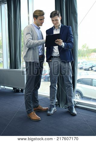 Two businessman dicussing business in the office