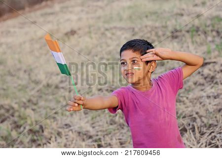 happy indian child saluting to indian flag