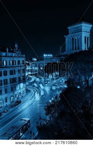 Street view at night with National Monument to Victor Emmanuel II in Rome, Italy.