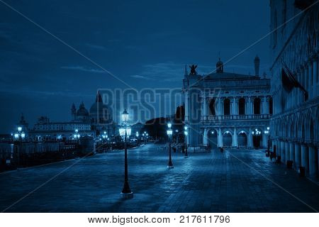 St Marks square at night with historical architectures and Santa Maria della Salute church in Italy.