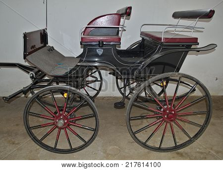 Vintage old style chariot in barn, close up