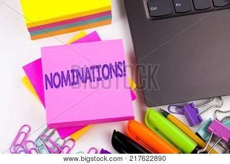 Writing text showing Nominations made in the office with surroundings such as laptop, marker, pen. Business concept for Election Nominate Nomination Workshop white background space