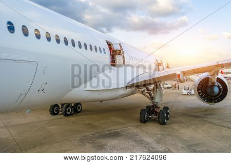 Passenger Aircraft Portholes, Doors, Wing. View From The Tail.