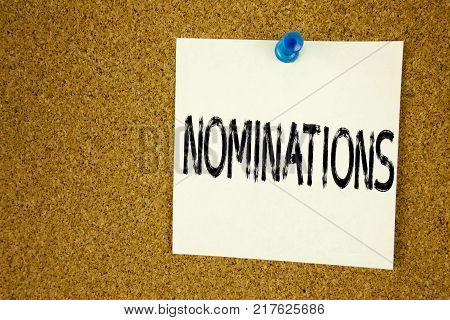 Conceptual hand writing text caption inspiration showing Nominations. Business concept for  Election Nominate Nomination written on sticky note, reminder cork background with space