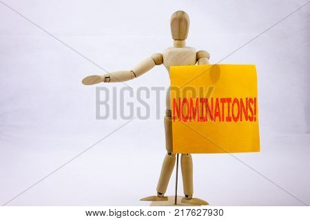 Conceptual hand writing text caption inspiration showing Nominations Business concept for Election Nominate Nomination on sticky note sculpture background with space