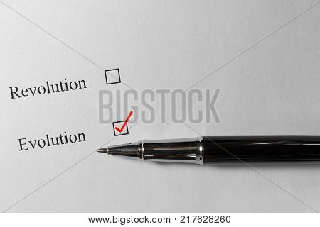 Questionnaire. The choice between revolution and evolution, the red check next to the choice.
