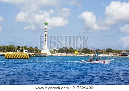 COZUMEL MEXICO - May 28 2016: Landscape of coastline and the monument of Apiqroo in Cozumel island Mexico May 28 2016