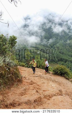 Paro, Bhutan - September 18, 2016: Two Tourist Women Hiking On The Way To Taktshang Palphug Monaster