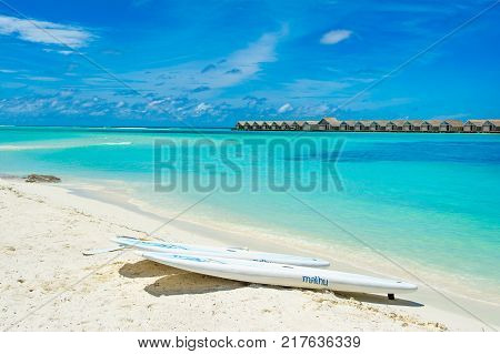South Atoll Dhidhoofinolhu Maldives - 24 June 2017: Stand up paddle board - SUP boards on a sandy beach Maldives