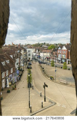 BATTLE ABBEY, BATTLE, EAST SUSSEX, UK, 13TH APRIL 2017 - Aerial view of Battle High Street through a stone window in Battle Abbey Battle Sussex England UK
