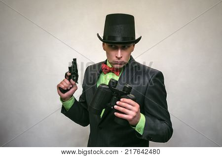 Spy. Secret detecive agent holds binoculars in his hands and looks through him isolated. Retro gangster.