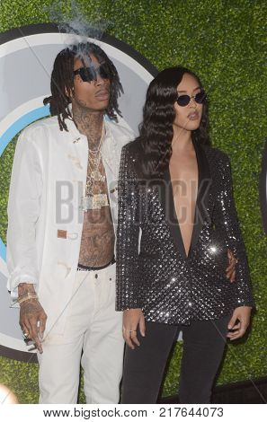 LOS ANGELES - DEC 7:  Wiz Khalifa, Izabela Guedes at the 2017 GQ Men of the Year at the Chateau Marmont on December 7, 2017 in West Hollywood, CA