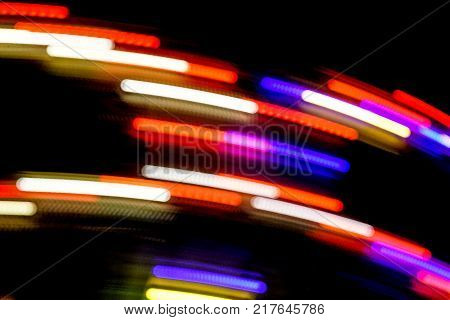 Blurred Motion Effect Around Of Brightly Illuminated Rotating High Speed Carousel