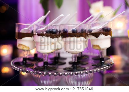 Colorful Wedding Candy Table with different goodies on display
