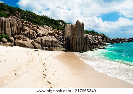 Footsteps on the pathway for an amazing natural beach tropical landscape Anse Marron La Digue Seychelles