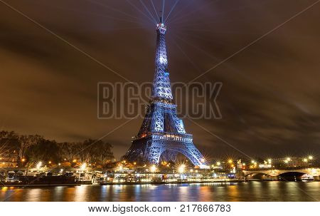 Paris, France-December 09, 2017 :The Eiffel Tower lit up with the message Merci Johnny-Thank you Johnny in French in Paris in memory of late French rock star Johnny Hallyday . French music icon Johnny Hallyday died on December 6, aged 74.