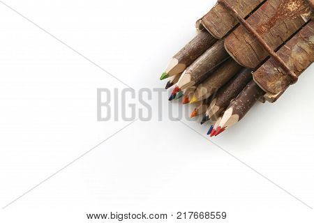 colorful wooden pencils on white surface in the studio