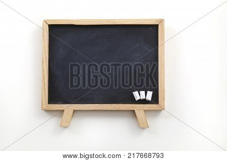 three small chalks on a blackboard white background