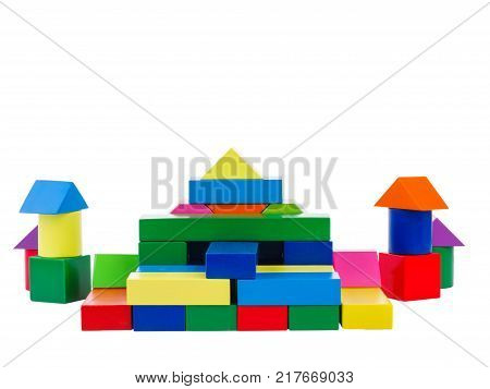 Wooden toys, child development, cubic multi-colored castle in the shape of a pyramid, lined up for the child, isolated on a white background.