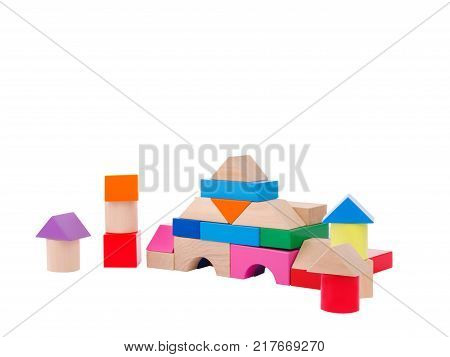 Wooden toys, child development, cubic multi-colored castle in the shape of a pyramid, with towers, lined for the child, front view, isolated on a white background.