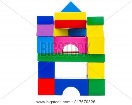 Wooden toys, child development, cubical multi-colored castle, lined up for the child, at the top is a blue triangle, front view, isolated on white background.